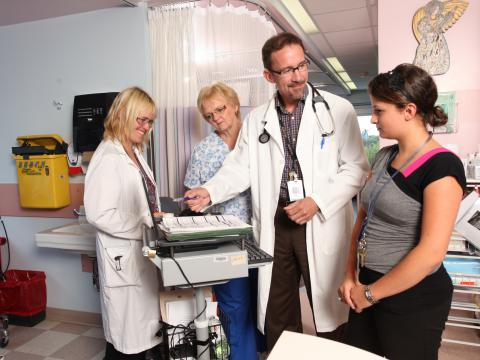 Ongologist with clinic staff at QHC Belleville General Hospital