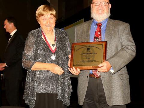 Dr. John Schreiner and American Association of Physicists in Medicine President Ms. Melissa Martin